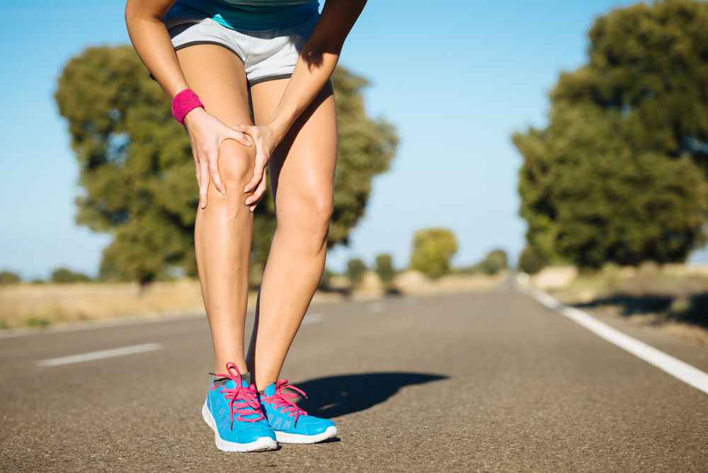 frau beim sport verletzt